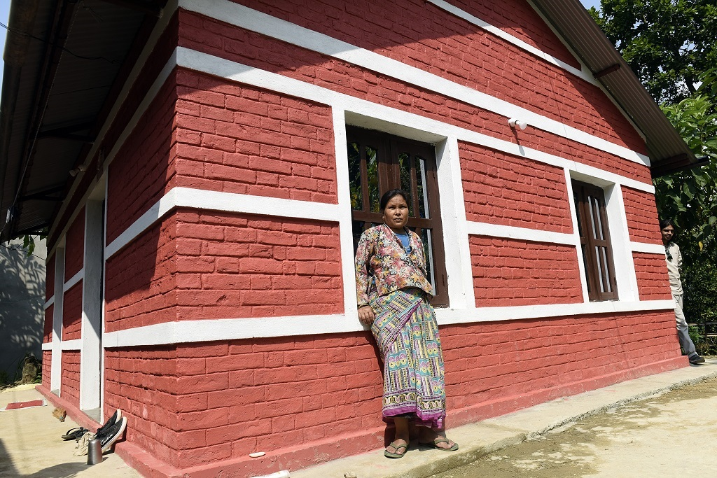 A beneficiary of kaski at her rebuilt house