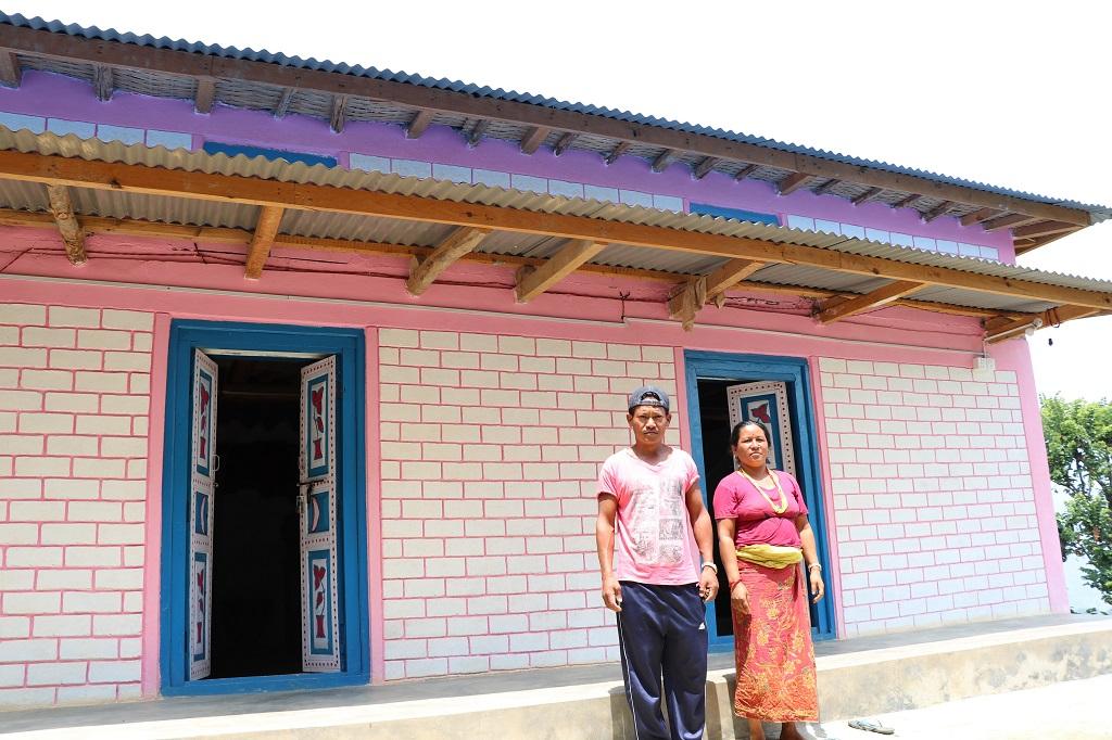 Tilak B. Magar and his wife Dil Kumari Magar at their newly rebuilt house at Jyamire, Siddhicharan Municipality-9, Okhaldhunga